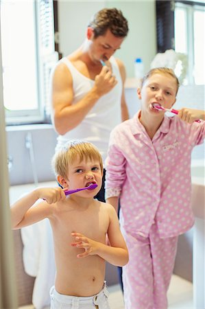 Father and children brushing teeth in bathroom Stock Photo - Premium Royalty-Free, Code: 6113-07242949