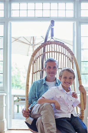 father with two sons not girls - Father and son sitting in wicker chair Stock Photo - Premium Royalty-Free, Code: 6113-07242967