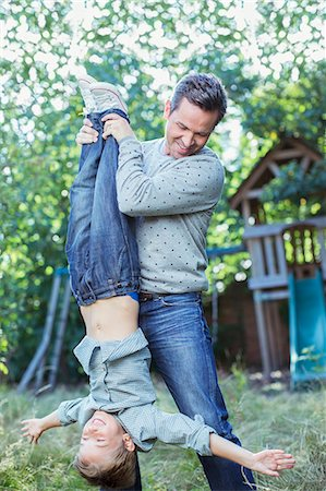 dangling - Father and son playing outdoors Stock Photo - Premium Royalty-Free, Code: 6113-07242972