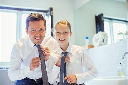 Father and daughter adjusting ties in bathroom Stock Photo - Premium Royalty-Free, Code: 6113-07242990