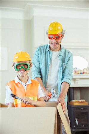safety - Father and son playing with construction toys Stock Photo - Premium Royalty-Free, Code: 6113-07242999