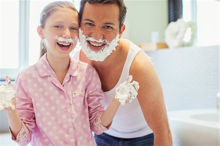 funny pose - Father and daughter playing with shaving cream Stock Photo - Premium Royalty-Free, Code: 6113-07242931