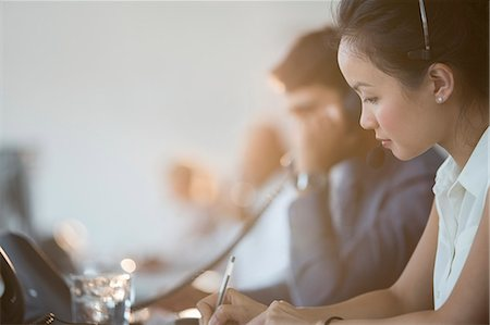 Business people working in office Stock Photo - Premium Royalty-Free, Code: 6113-07243043