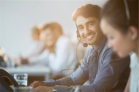Businessman wearing headset in office Stock Photo - Premium Royalty-Free, Code: 6113-07243041