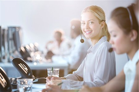 Businesswoman wearing headset in office Stock Photo - Premium Royalty-Free, Code: 6113-07243047