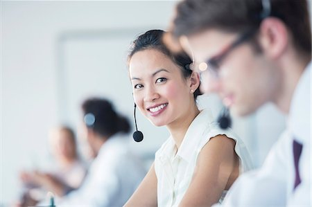 Businesswoman wearing headset in office Stock Photo - Premium Royalty-Free, Code: 6113-07243046