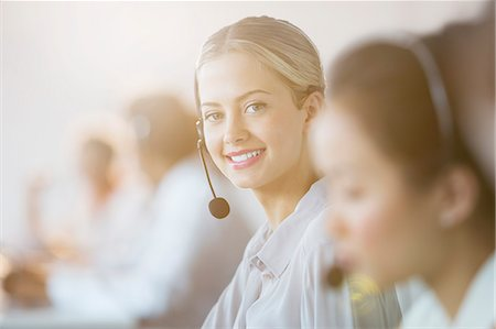 sale - Businesswoman wearing headset in office Stock Photo - Premium Royalty-Free, Code: 6113-07243052