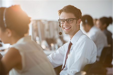 Businessman wearing headset in office Stock Photo - Premium Royalty-Free, Code: 6113-07243056