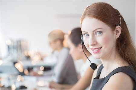 services - Businesswoman wearing headset in office Stock Photo - Premium Royalty-Free, Code: 6113-07243061