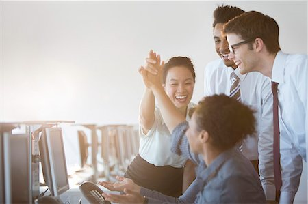 five - Business people cheering in office Stock Photo - Premium Royalty-Free, Code: 6113-07243067