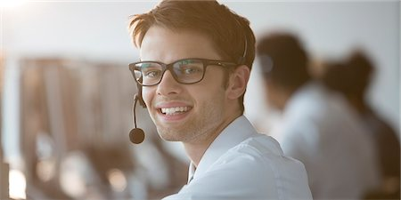 Businessman wearing headset in office Stock Photo - Premium Royalty-Free, Code: 6113-07243070