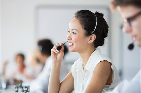 Businesswoman wearing headset in office Stock Photo - Premium Royalty-Free, Code: 6113-07243071
