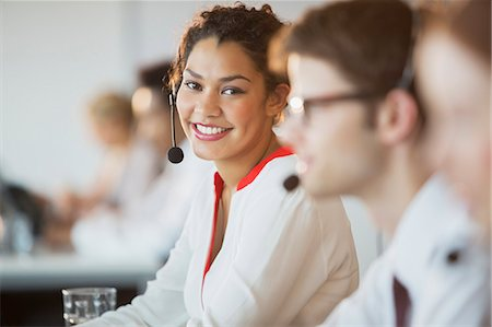 Businesswoman wearing headset in office Stock Photo - Premium Royalty-Free, Code: 6113-07243080