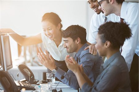 five people - Business people cheering at computer in office Stock Photo - Premium Royalty-Free, Code: 6113-07243081
