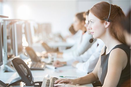 Businesswoman wearing headset in office Stock Photo - Premium Royalty-Free, Code: 6113-07243082
