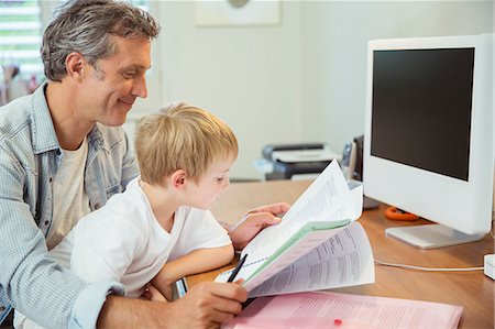 father with two sons not girls - Father and son working in home office Stock Photo - Premium Royalty-Free, Code: 6113-07243007
