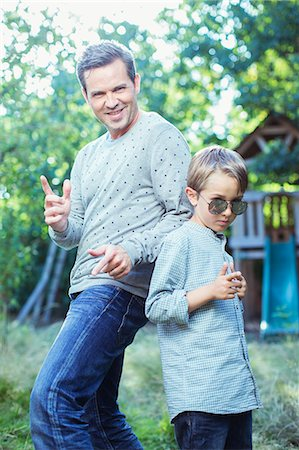 father with two sons not girls - Father and son gesturing outdoors Stock Photo - Premium Royalty-Free, Code: 6113-07243017