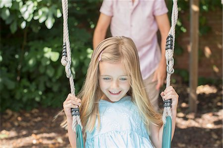 swing (sports) - Father pushing daughter on swing Stock Photo - Premium Royalty-Free, Code: 6113-07243022