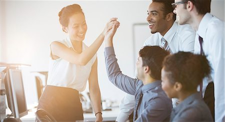 five - Business people cheering in office Stock Photo - Premium Royalty-Free, Code: 6113-07243035