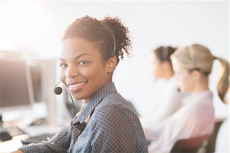 Businesswoman wearing headset in office Stock Photo - Premium Royalty-Free, Code: 6113-07243036