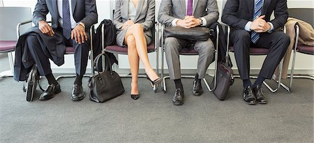 Business people sitting in waiting area Stock Photo - Premium Royalty-Free, Code: 6113-07243141