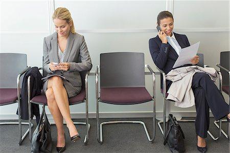 Businesswomen sitting in waiting area Stock Photo - Premium Royalty-Free, Code: 6113-07243144