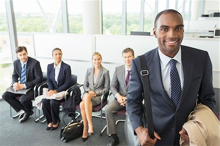 Businessman smiling in office Stock Photo - Premium Royalty-Free, Code: 6113-07243159