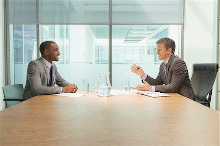 Businessmen talking in meeting Stock Photo - Premium Royalty-Free, Code: 6113-07243165