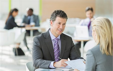 Business people talking in office Stock Photo - Premium Royalty-Free, Code: 6113-07243189