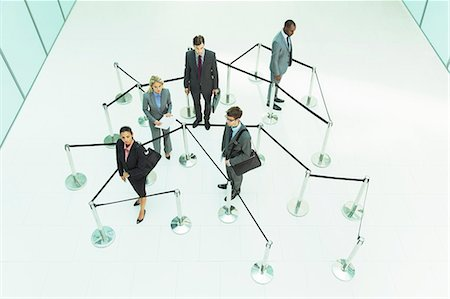 Business people waiting in roped off area Stock Photo - Premium Royalty-Free, Code: 6113-07243106