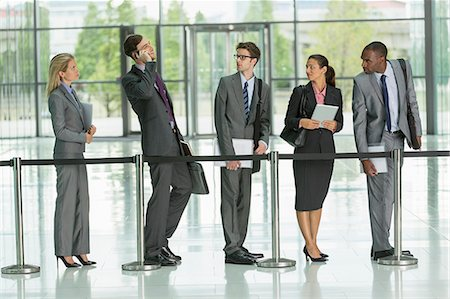 Businessman talking on cell phone in line Stock Photo - Premium Royalty-Free, Code: 6113-07243117