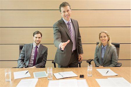 Businessman extending handshake in meeting Stock Photo - Premium Royalty-Free, Code: 6113-07243133