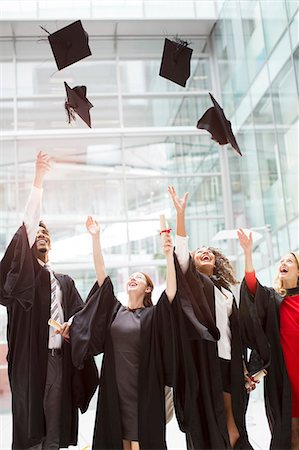 Graduates tossing caps in air Stock Photo - Premium Royalty-Free, Code: 6113-07243267