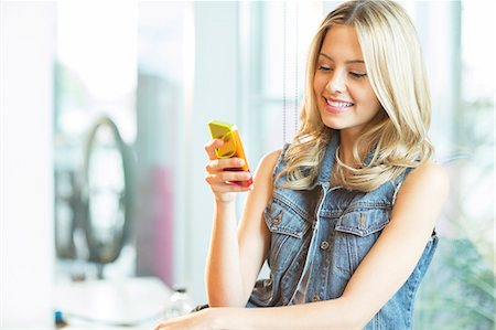 Woman using cell phone Stock Photo - Premium Royalty-Free, Code: 6113-07243287