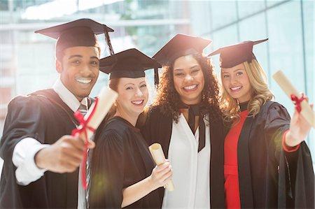 Graduates smiling with diploma Stock Photo - Premium Royalty-Free, Code: 6113-07243289