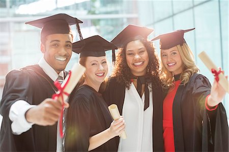 Graduates smiling with diploma Stock Photo - Premium Royalty-Free, Code: 6113-07243289