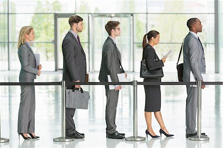 five people - Business people waiting in line Stock Photo - Premium Royalty-Free, Code: 6113-07243207