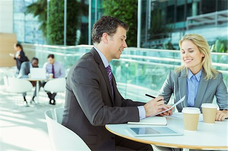Business people talking in cafe Stock Photo - Premium Royalty-Free, Code: 6113-07243215
