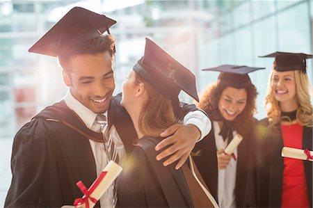 Graduates hugging Stock Photo - Premium Royalty-Free, Code: 6113-07243390