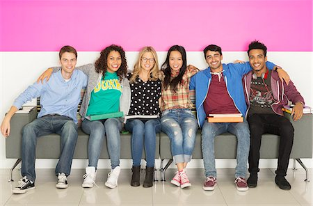 University students smiling on bench Stock Photo - Premium Royalty-Free, Code: 6113-07243397