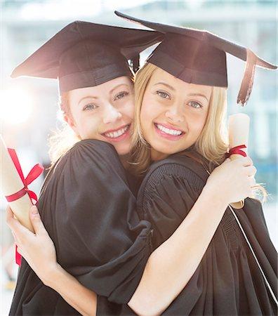 Smiling graduates hugging Stock Photo - Premium Royalty-Free, Code: 6113-07243323