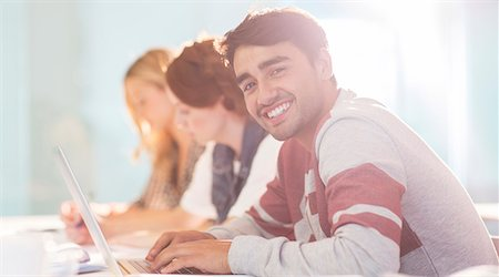 University student smiling in classroom Stock Photo - Premium Royalty-Free, Code: 6113-07243329