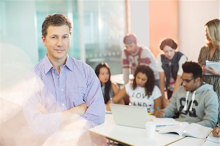 Professor standing in classroom Stock Photo - Premium Royalty-Free, Code: 6113-07243331
