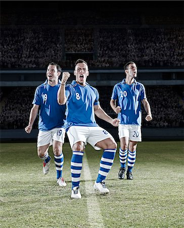football team - Soccer players cheering on field Stock Photo - Premium Royalty-Free, Code: 6113-07310540