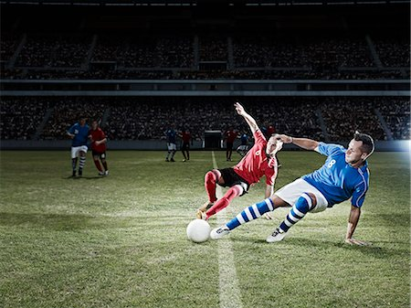 footballeur - Soccer players kicking for ball on field Stock Photo - Premium Royalty-Free, Code: 6113-07310546