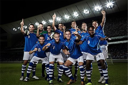 football team - Soccer team cheering on field Stock Photo - Premium Royalty-Free, Code: 6113-07310549