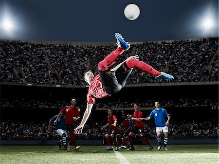 soccer player (male) - Soccer player kicking ball on field Stock Photo - Premium Royalty-Free, Code: 6113-07310552