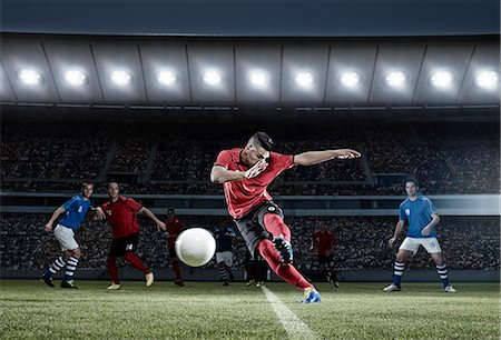 soccer player (male) - Soccer player kicking ball on field Stock Photo - Premium Royalty-Free, Code: 6113-07310554