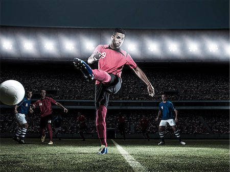 soccer player (male) - Soccer player kicking ball on field Stock Photo - Premium Royalty-Free, Code: 6113-07310559