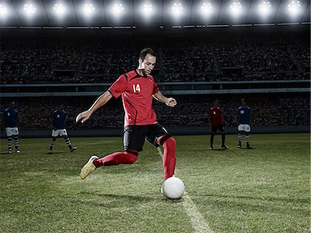 soccer player (male) - Soccer player kicking ball on field Stock Photo - Premium Royalty-Free, Code: 6113-07310563